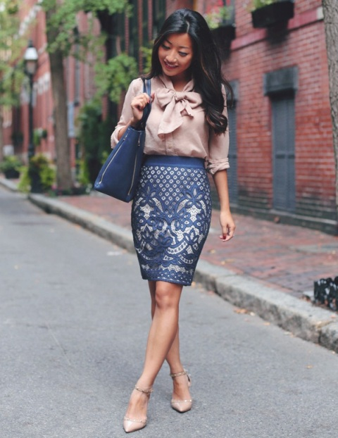 With printed skirt, blue bag and beige pumps