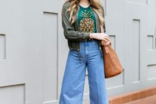 With printed t-shirt, olive green jacket, denim culottes and brown tote