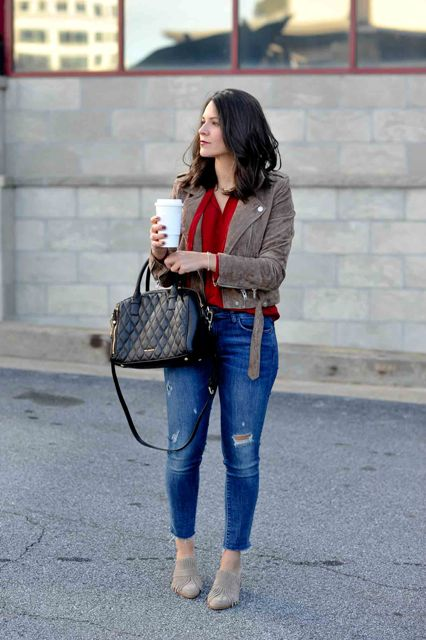 With red blouse, suede jacket, black bag and distressed jeans