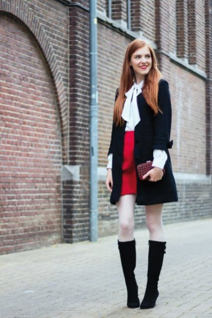 With red high-waisted skirt, black coat, clutch and black high boots