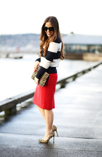 With red knee-length skirt, leopard clutch and leopard pumps