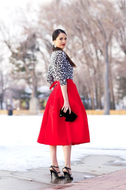 With red midi skirt, black clutch and black high heels