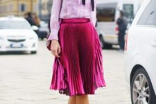 With ruffled blouse, pleated skirt and bag