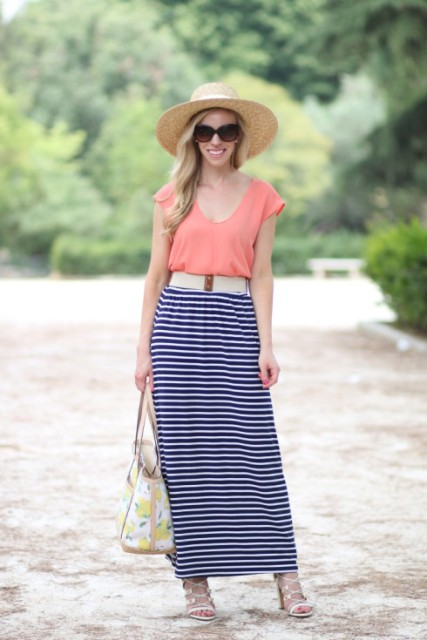 With shirt, white belt, wide brim hat, lace up sandals and printed bag