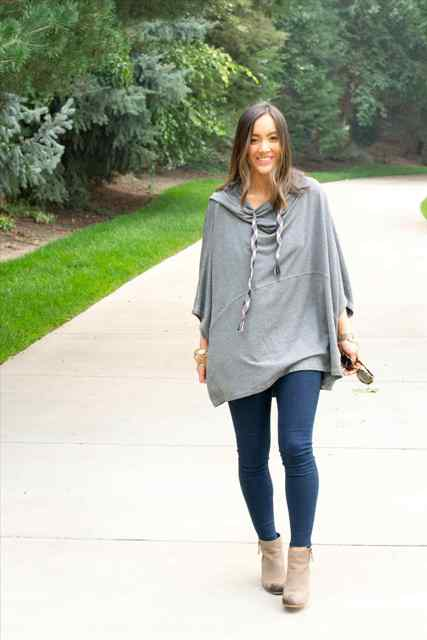 With skinny jeans and gray ankle boots