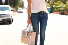 With skinny pants, leather bag and pumps
