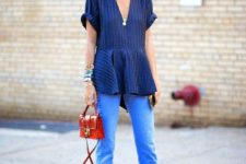 With striped blouse, straight jeans and red mini bag