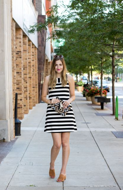 With striped dress and printed clutch