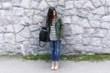 With striped loose shirt, distressed jeans, beige boots and black bag