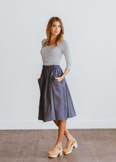 With striped shirt and A-line skirt