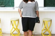 With striped shirt, black culottes and chain strap bag