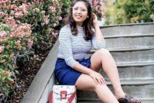 With striped shirt, denim skirt and printed bag