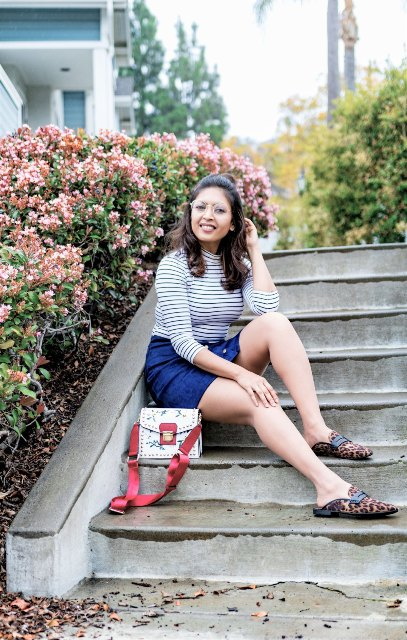 With striped shirt, denim skirt and printed bag
