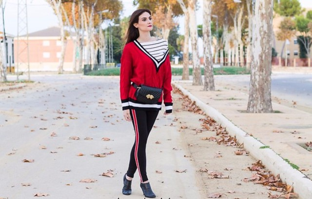 With striped shirt, leggings, waist bag and flats