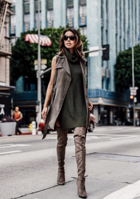 With suede vest, sunglasses and high heeled boots