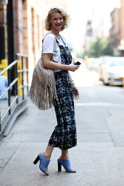 With t-shirt, printed maxi dress and gray fringe bag