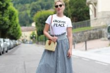 With t-shirt, straw bag and platform sandals