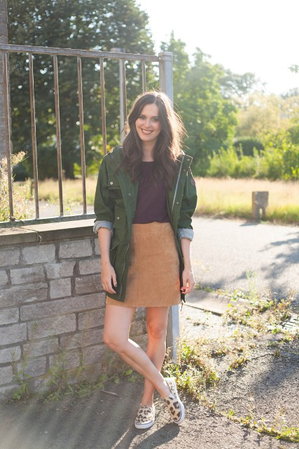 With t-shirt, suede skirt and leopard slip on shoes