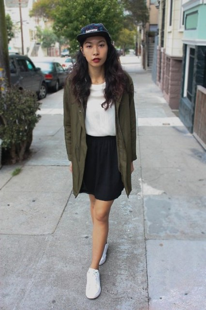 With white blouse, mini skirt, cap and white sneakers