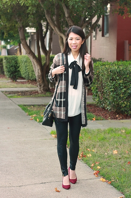 With white blouse with black bow, black small bag, black skinny pants and red pumps