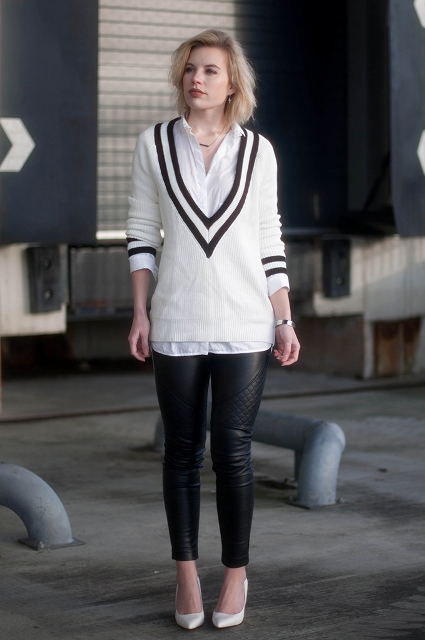 With white button down shirt, leather pants and white pumps
