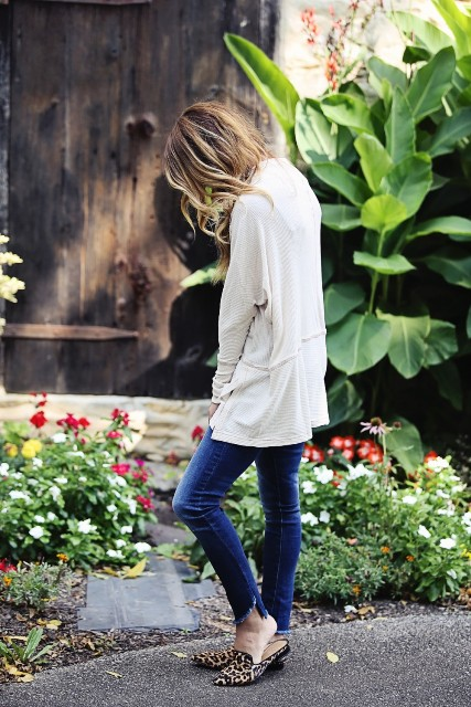 With white cardigan and jeans
