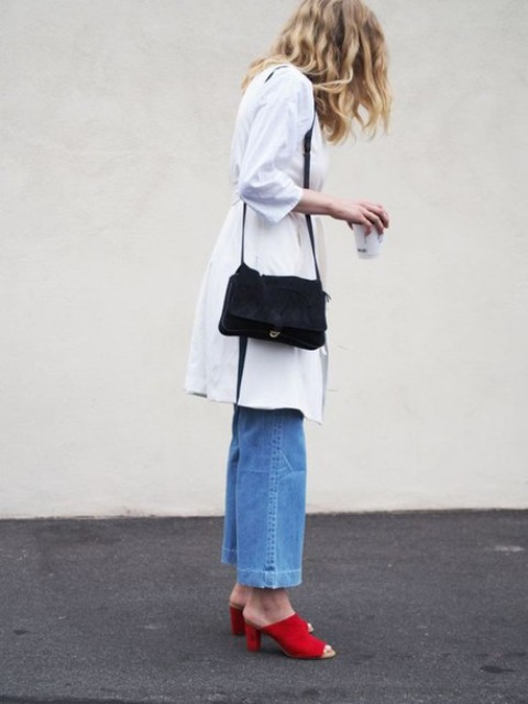 With white coat, black bag and jeans