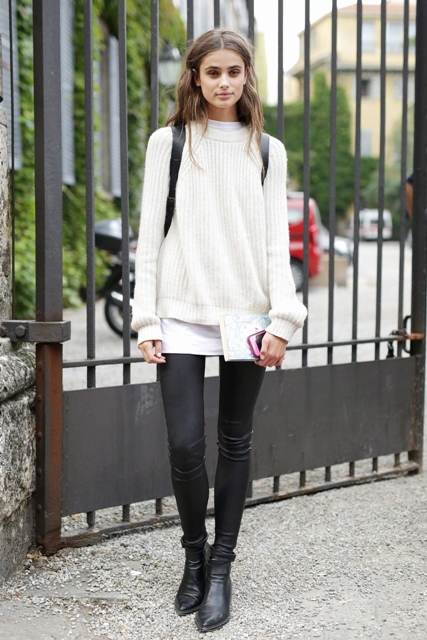 With white long shirt, black skinny pants, boots and backpack