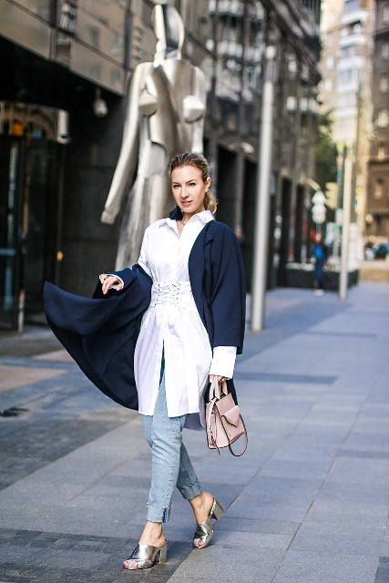With white long shirt, navy blue jacket, leather bag and cuffed jeans