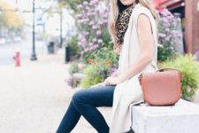 With white long vest, pink bag, leopard scarf and skinny jeans