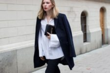 With white loose shirt, navy blue jacket, clutch and skinny pants