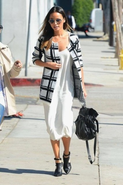 With white midi dress, black leather bag and black cutout boots