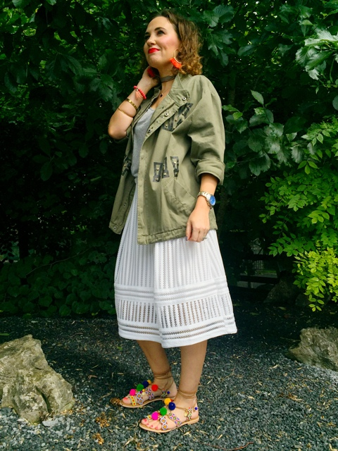 With white midi skirt, t-shirt and lace up sandals