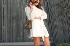 With white mini dress and bag