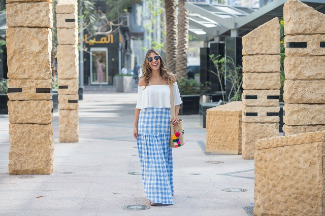 With white off the shoulder blouse and tote