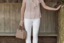 With white pants, small leather bag and lace up high heels
