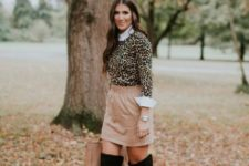 With white shirt, beige skirt, over the knee boots and beige bag