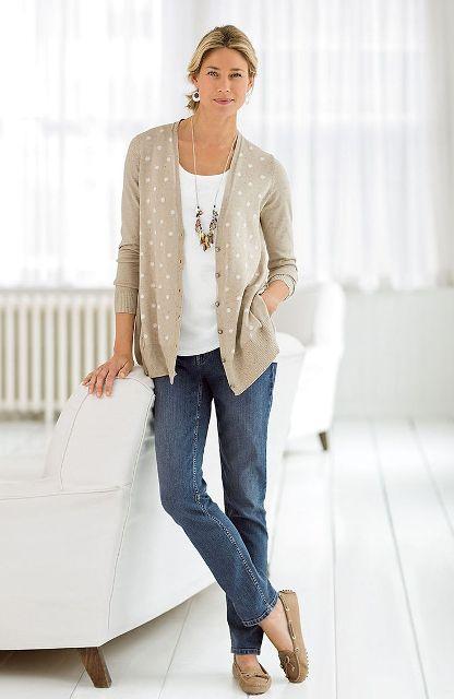 With white shirt, jeans and flat shoes