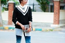With white shirt, jeans, pumps and striped clutch