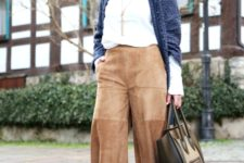 With white shirt, navy blue cardigan, bag and leopard shoes
