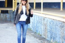 With white shirt, skinny jeans and black waterfall jacket
