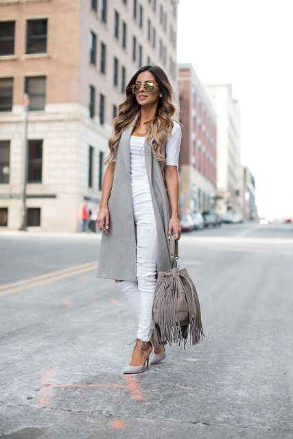 With white shirt, white pants, gray pumps and fringe bag