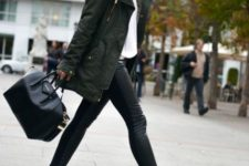 With white shirt, white sneakers, black tote and leather pants