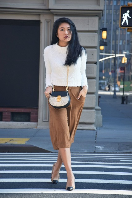 With white sweater, two colored bag and two colored pumps