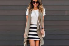 With white t-shirt, crossbody bag, striped skirt and mules