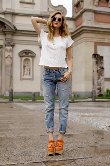 With white t-shirt, distressed jeans and sunglasses