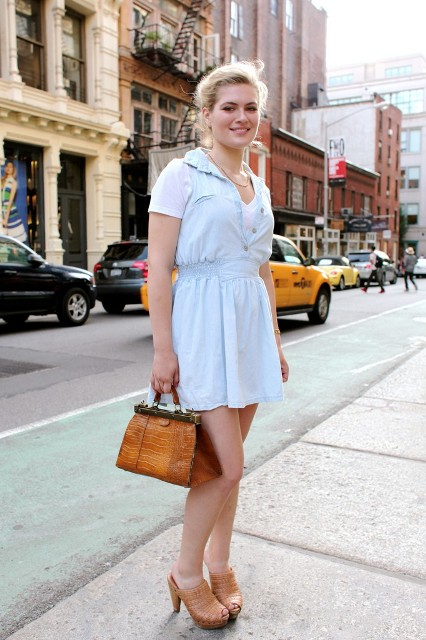 With white t-shirt, light blue mini dress and brown bag