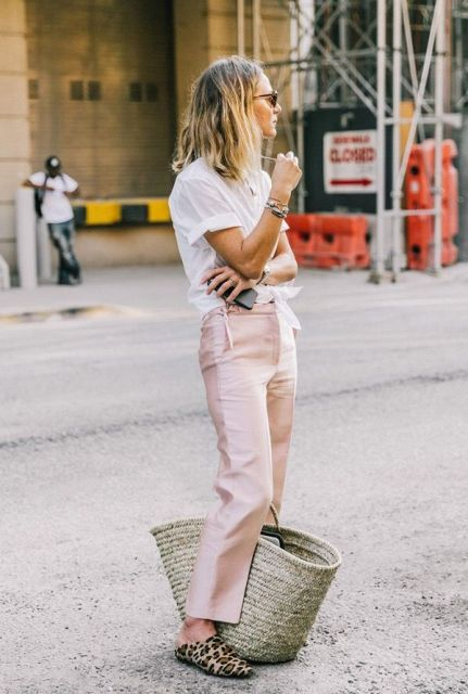 With white t-shirt, pale pink trousers and tote