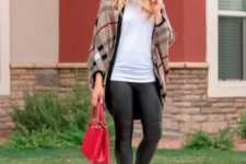 With white t-shirt, red bag, heeled boots and black leggings