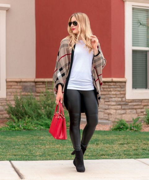 With white t shirt, red bag, heeled boots and black leggings